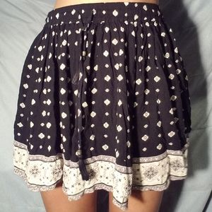 Boho black and white skirts with tassels